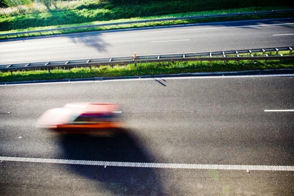 Speeding car on highway