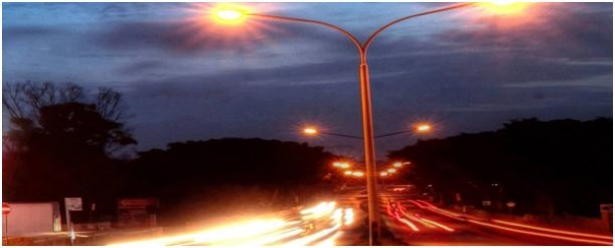 Streetlight with cars passing by