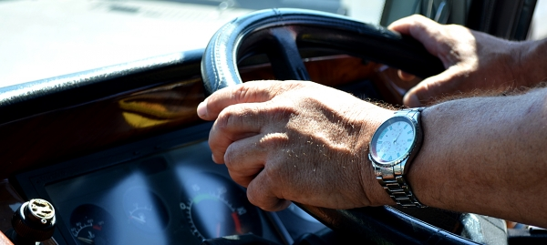 Bus drivers hands on the steeringwheel